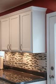 crown molding for kitchen cabinet tops budget kitchen makeover laminate countertops countertops and moldings