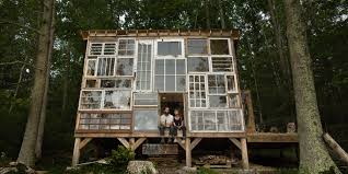 cozy mountain cabin built from repurposed windows costs just 500