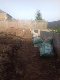 landscaping can a retaining wall follow a slope home