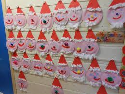 Primary Christmas Crafts - painted santa display classroom display class display creative