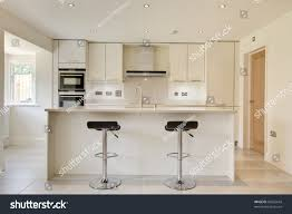 modern cream kitchen contemporary modern cream colored luxury kitchen stock photo