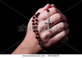 a rosary praying holding rosary jesus stock photo 753703075