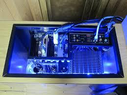 custom computer built inside desk shelving logitech intel