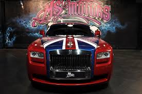 rolls royce gold and red rolls royce ghost with a holiday wrap by ms motors