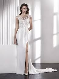 lacey mermaid wedding dress with illusion neckline and cap sleeves