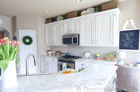 How To Paint The Kitchen Cabinets How To Paint Your Cabinets Like The Pros And Get The Grain Out