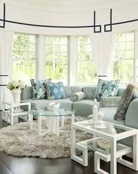 bay window seat curved sectional sofa and three coffee table and