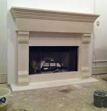 neo gothic limestone mantel with tudor rose details fireplace