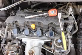 new honda civic hatchback mk9 2013 engine and spark plugs inspection