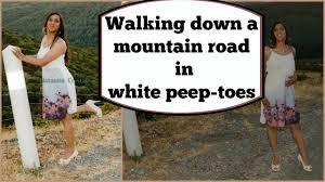 crossdresser stockings high heels crossdresser walking down a mountain road in white peeptoe high