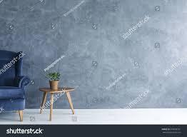 interior grey wall blue armchair wood stock photo 570656701