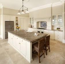 White Cabinet Kitchen Kitchen With Off White Cabinets Stone Backsplash And Bronze