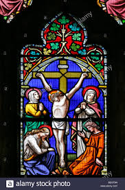 a stained glass window depicting the crucifixion of jesus christ