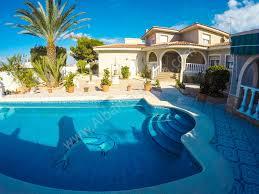 mediterranean style villa with a large garden