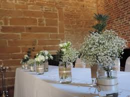 wedding flowers liverpool blue and white wedding wedding flowers jars roses gypsophila