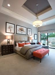 monticello homes grey bedroom pops of spiced orange dark wood