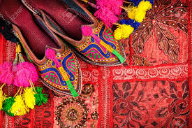 colorful ethnic shoes and camel decorations on rajasthan