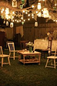 hanging outdoor lights best backyard string lights ideas on patio hanging outdoor brick garden party at night lanterns hang from tree branches and rustic
