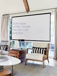 for the living room our new hidden living room projector system emily henderson