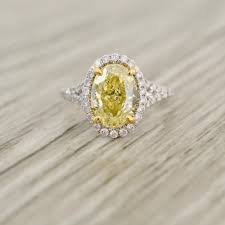 fancy yellow diamond engagement rings yellow oval brilliant in a true pavé halo diamond stem