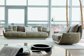 the curved sofa design of the nadja sofa helps to create a