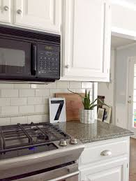 kitchen cabinets with backsplash our white kitchen cabinets granite emily a clark