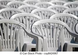 pictures of aligned white plastic chairs view of some white