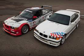 the no 6 bmw team ptg m3 race car poses with its street car