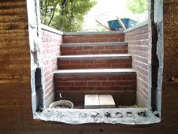 exterior design chic egress window wells with retaining wall for
