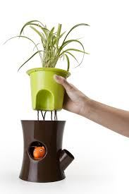 log u0026 squirrel self watering plant pot by qualy brown green