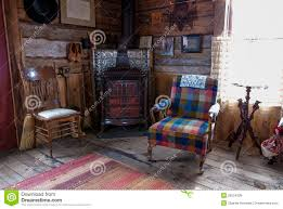 log cabin living room with chairs and fireplace royalty free stock
