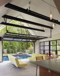 modern sunroom design inspiration with yellow futon set and nice garage door opener spectacular pool house design connecting home interiors and swimming pool garage security tips build a smartphone connected garage door