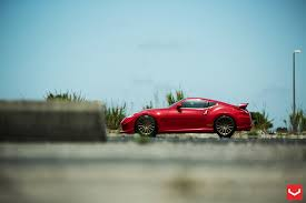 nissan 370z custom rims nismo 370z goes red on vossen wheels video autoevolution
