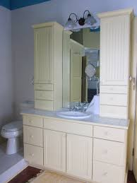Bathroom Countertop Storage by White Wooden Storage With Three Glass Shelves Between Mirrors