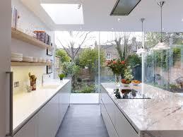 handleless matt lacquer kitchen with oak box shelves corian