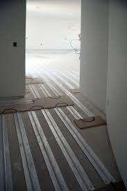 Laminate Floor Heating Thermofin U Extruded Aluminum Heat Transfer Plates Are Installed