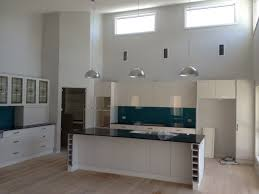 galley style kitchen with raked ceilings and hi lite windows