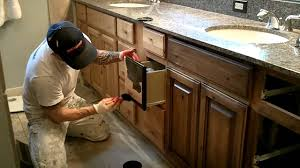 using toner and glaze to darken existing cabinets water damage