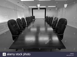Wooden Boardroom Table Long Wooden Boardroom Table Surrounded By Expensive Leather Chairs