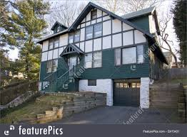 old fashioned house photo of green tudor old fashioned house