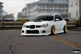 subaru gold subaru wrx station wagon sporting gold custom painted rims by