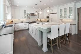 gray kitchen island with l shaped breakfast bar transitional