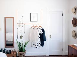how to create a minimalist closet display for a capsule wardrobe
