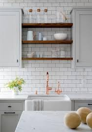 how to open kitchen faucet light gray and white kitchen boasts a farmhouse sink paired with a