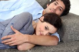 Free Hug Sofa by Couple Lying On Sofa Stock Photo Picture And Royalty Free Image