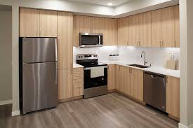 kitchen backsplash with oak cabinets and white appliances apartments at avalon newcastle commons newcastle