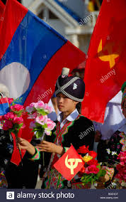 Red Flags Festival Hmong Dressed In Traditional Clothing Holding Red