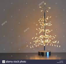 stylised silver metal and wire tree with white lights