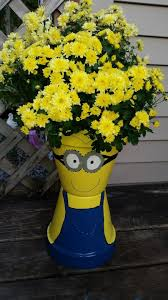 lots of minion terra cotta pots ideas and pictures below learn