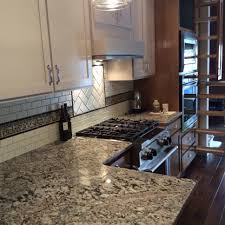custom kitchen with lennon granite countertops subway tile and